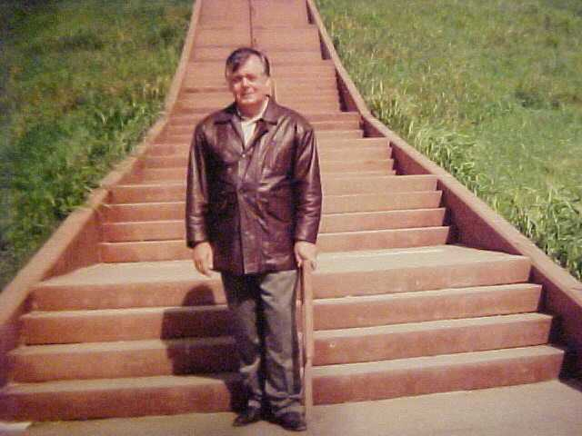 Daniel Bierman standing on the steps of the Monk Mound located in Cahokia Il.